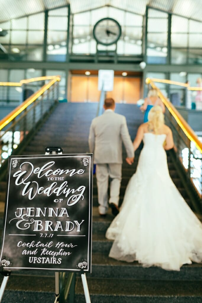 Bride and groom walking up the stairs at the Bellingham Cruise Terminal to the reception