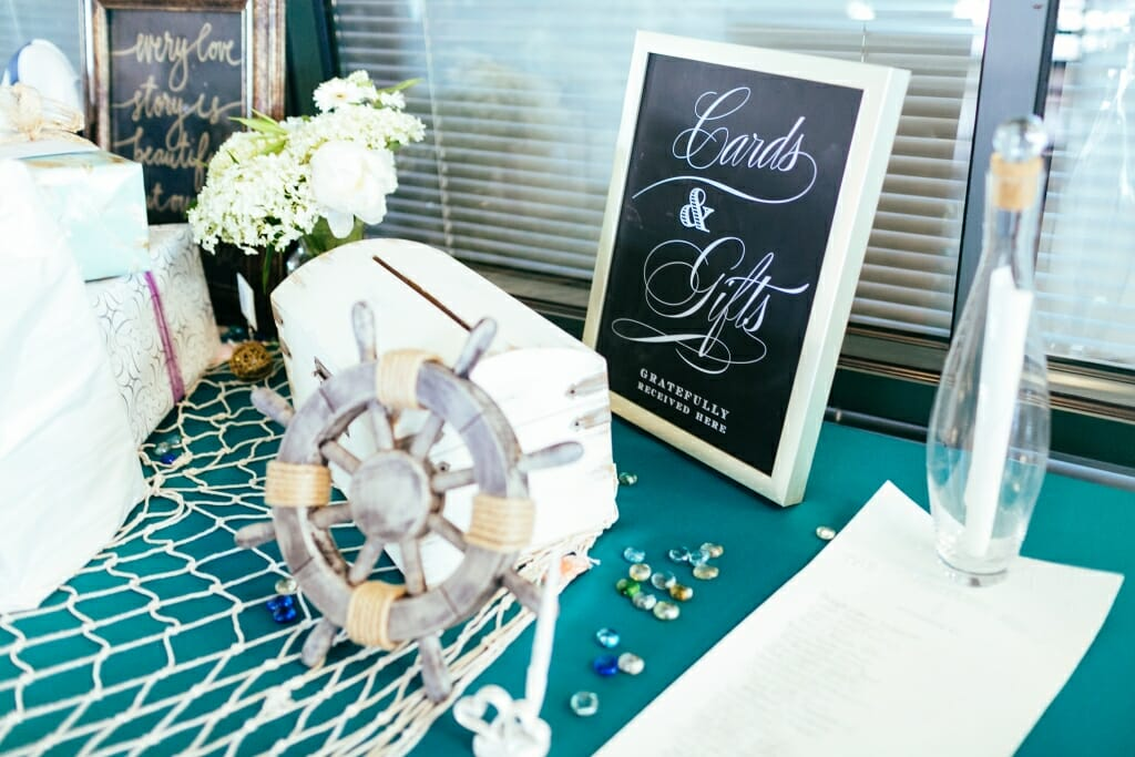 The nautical themed card and gift table at the wedding reception