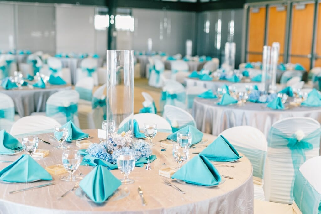 Nautical themed wedding reception room setup in grey and turquoise