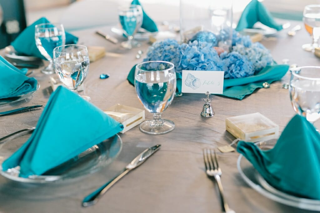 A seascape themed guest table at the wedding reception