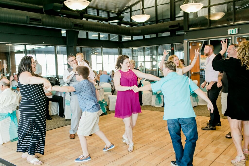 Guest dancing at a wedding reception at the Bellingham Cruise Terminal