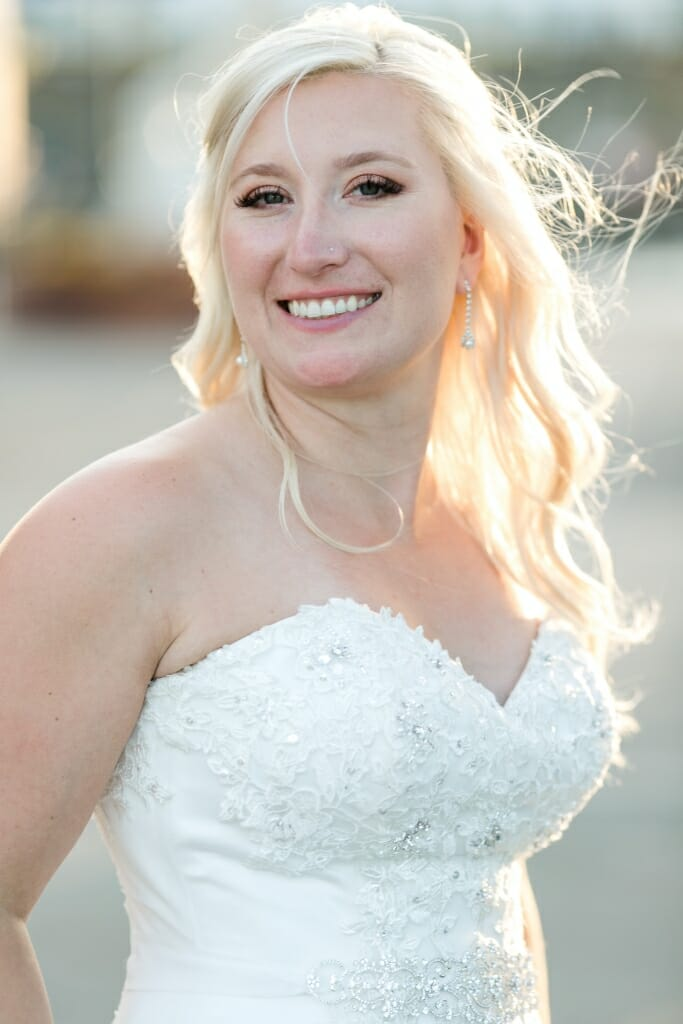 Bride all smiles after the wedding at Fairhaven Marine Park