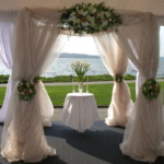 A Mode Events beautiful tent and draping with florals on the waterfront