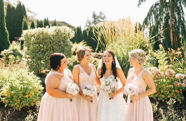 Bride and bridesmaids before the ceremony at Lord Hill Farms venue