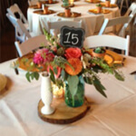 Bright colorful orange and pink floral centerpiece