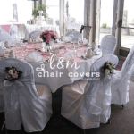 L&M Chair Covers logo with white reception chairs and table setup