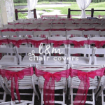 L&M Chair Covers logo with white and pink wedding ceremony setup